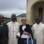 Betty with the executive director of Global Outreach, the bishop who provided space for the GO office and an Internet library, and a parish priest.