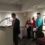 Sebastian Galbo, vice president of NU's chapter of Phi Sigma Tau, speaks at the podium.