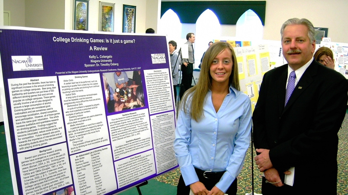 Dr. Osberg of psychology with one of his students at the Undergraduate Research Conference.