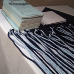 Honors cords and Dialogue, the society's journal, are aligned neatly before the induction ceremony.
