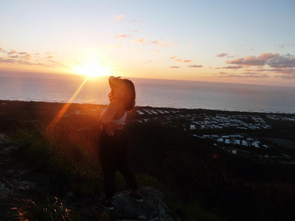 Vanessa enjoying the sunset at Mt. Coolum.