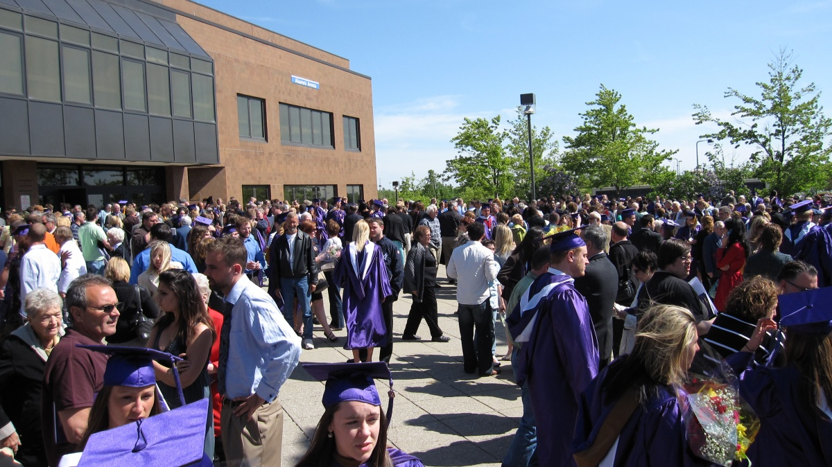 Students, Faculty, and Families get together after Commencement