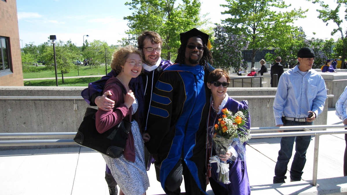 Students and Faculty Celebrating Graduation