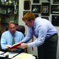 Josh Jensen, '10, advises Senator Joseph E. Robach, 56th Senate District, about public position on a variety of issues.