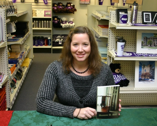 Dr. Shannon Risk signed copies of her latest book at an event In the Niagara University Campus Store on Dec. 6.