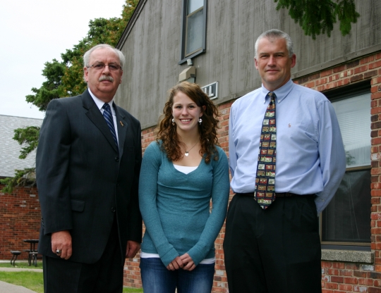 Andrew Goralski, chair of the Buffalo chapter of the Society of Former Special Agents of the FBI, scholarship recipient Elizabeth Berger, and Dr. Timothy Ireland, chair of NU's Department of Criminal Justice.