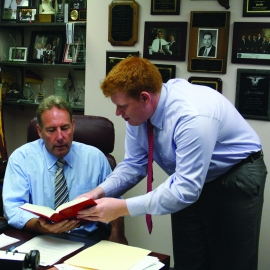 Josh Jensen, '10, advises Senator Joseph E. Robach, 56th Senate District, about publicposition on a variety of issues.