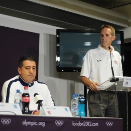 Bill Kellick, '89 (standing), at a press conference during the London Olympics.