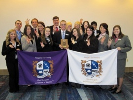 Students from Niagara University's chapter of the Club Managers Association of America celebrate being recognized as the Student Chapter of the Year for a third straight year.