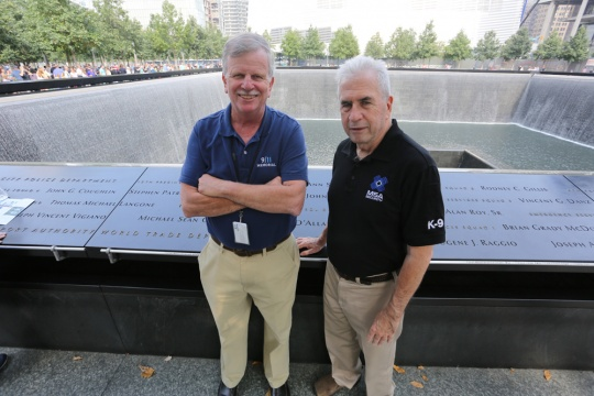 Larry Mannion, '68 (left), and George Harvey, '68, at the 9/11 Memorial. The two have been working together for three years to ensure the safety of visitors to the site.