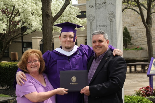 The Knight family: Debbie, '87, Michael Jr., '13, and Michael Sr., '87