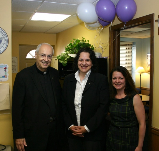 Carolyn Makey, center, receives the Outstanding Employee of the Quarter Award from the Rev. Joseph L. Levesque, C.M., and Stephanie Currie.