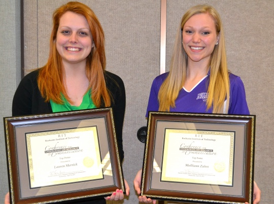 Niagara University seniors, l-r, Lauren Merrick and Molliann Zahm were presented with awards for presentations they made at the Conference for Undergraduate Research in Communication.