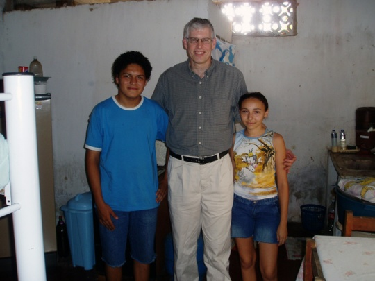 Scott Fina, '80, visiting the home of a family in the barrio in Fortaleza, Brazil.