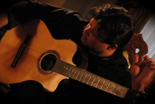 Mir Ali shows off his guitar playing prowess at Niagara University on April 25, 2012.