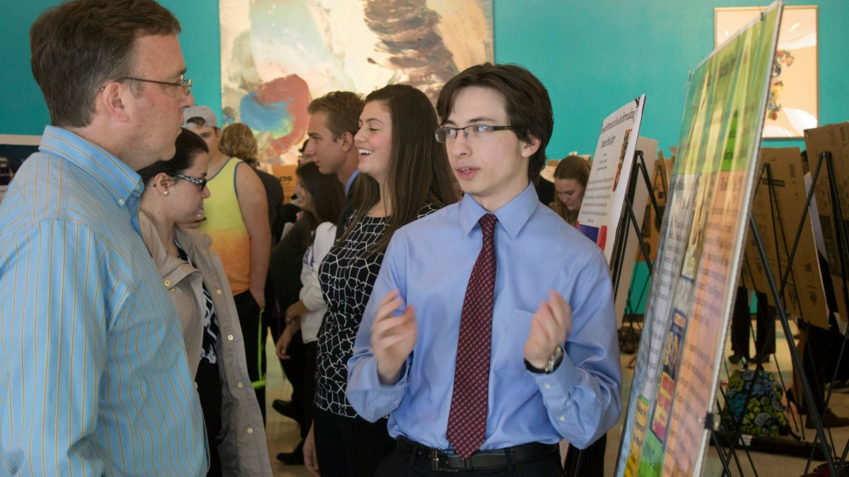 Marco Notaro explains his research to Dr. Robert Kane at the 2015 Undergraduate Research Conference.